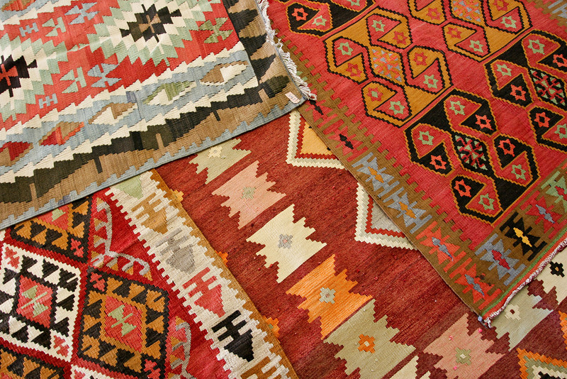 These are a few of the huge mountain of rugs my father brought back from his trip to Turkey.  Actually, to be specific these are kilims (as knotted rugs are called) as opposed to woven or pile rugs or carpets.<br /> <br /> The über-sexy one in the upper left corner is one that I have in my apartment.  Nice, huh?<br /> <br /> Lens used: 17-40mm f4.0