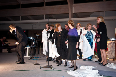 Choir having fun discarding their robes and rocking with Paul.