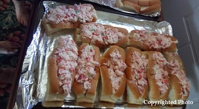 Yummy lobster rolls. Delicious. Betty Weston and Kathy Holloway did a fine job slapping the lobster mix in the buns. Many hands make light work.