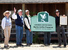 Marty Griffin(second from left) waves to his adoring fans after Audubon Canyon Ranch officials read the proclamation renaming the Bolinas Lagoon Preserve to the Martin Griffin Preserve on his 90th birthday celebration at Audubon Canyon Ranch in Stinson Beach, CA,  Saturday, July 24, 2010. Left to right - Joyce Griffin, Marty's wife, Marty Griffin, Audubon Canyon Ranch Executive Director  J. Scott Feirabend, and ACR Board President Andy Lafrenz  present the new sign.(Jocelyn Knight Photo)