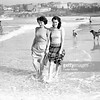 Nancy Britton and Ena Clayton at Bondi Beach, Sydney, 7 June 1948.<br /> Sun Picture by Johnson<br /> <br /> No neg number – From box 'Sun, Surfing 1947-1949'<br /> <br /> Black and white, history, archival, beaches, fashion, pets, pet, paddling, 1940s