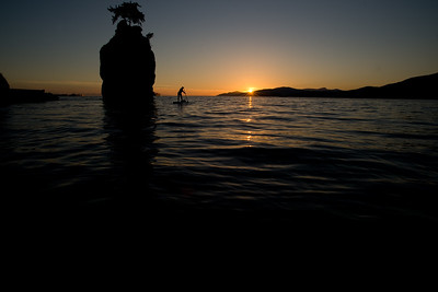 Stand up Paddleboarding around Siwash Rock. Stanley Park, Vancouver, British Columbia