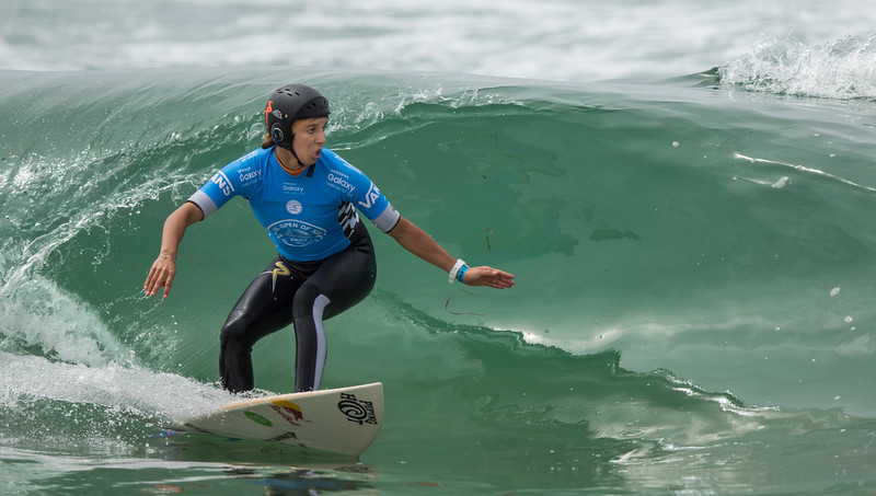 This is Sally Fitzgibbons competing in the Vans 2015 US Open of Surfing on August 2, 2015 in Huntington Beach, California. This is during Heat 2 of the Semifinals against Courtney Conlogue. Fitzgibbons won this heat and moved on to the Final. (© Erica Jacques 2015)