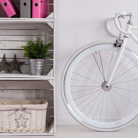 White bike and handmade bookcase