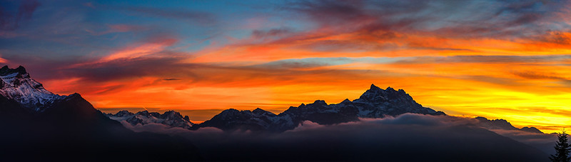 Majestic colorful sunset over the mountains, panoramic view