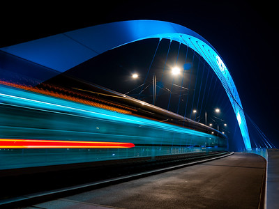 Lighted tram bridge at night. Strasbourg. Moving tram. Passerelle de la Citadelle