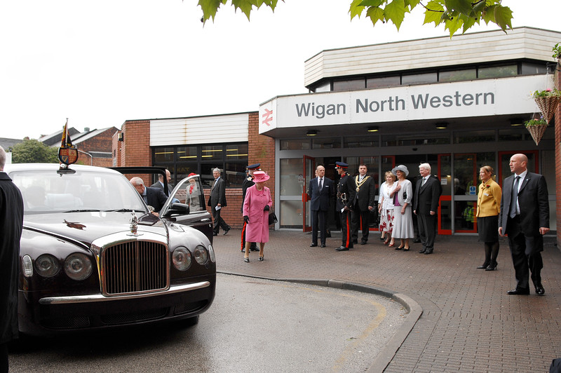 HRH The Queen and The Duke of Edinburgh arrive at Wigan North Western Railway Station, met by the new Mayor and Mayoress of Wigan, Coun Mark and Coun Karen Aldred, in their second day in post.  Picture by Nick Fairhurst/©Johnston Press