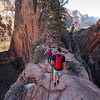 A couple hiking in Zion.