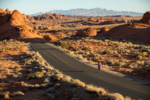 A woman running at sunrise in the desert