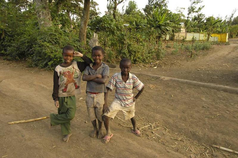 x_48 three local Maasai farmers' kids