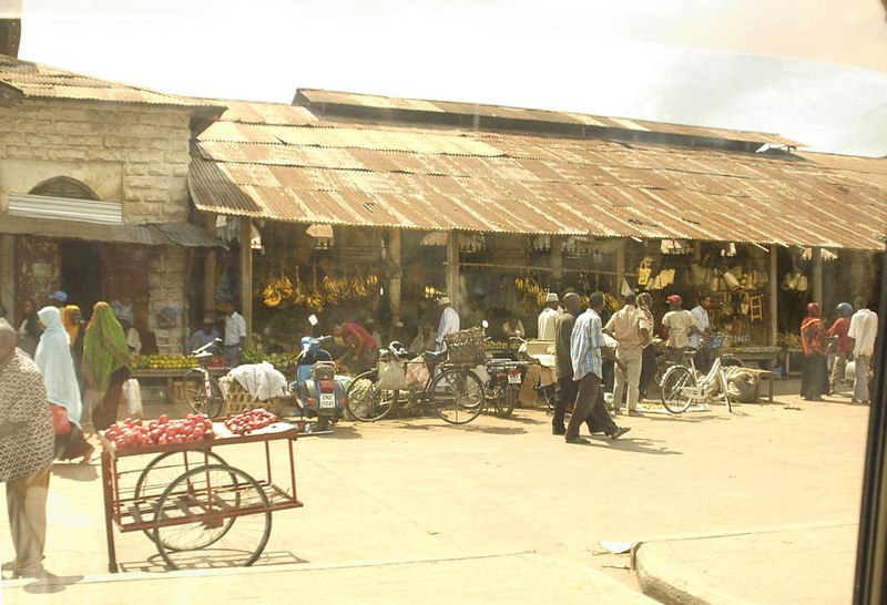 x_23 open market along road through town