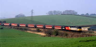 -- 2002 -- Freightliner's Class 47/0 #47289 leads an off lease Virgin Trains HST set, with power cars #43157 and #43050; on the climb from Totnes to Dainton Tunnel at Bow Bridge heading for Derby from Laira Depot in Plymouth.