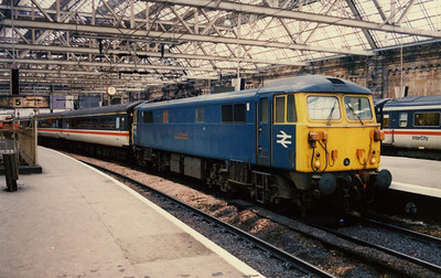 """-- 1989 --- The unique Class 87/1 # 87101, """"Stephenson""""; stands under the roof of Glasgow Central station waiting to depart south with a train comprised of InterCity Mk 2 stock."""