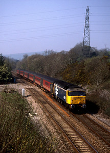 """-- 2002 -- The 11:50 Virgin Cross Country service from Plymouth to Liverpool Lime Street led by Brush built Class 47/8 #47847, """"Brian Morrison/Railway World Magazine""""; heads east away from Marley Tunnel and begins the descent of Rattery."""