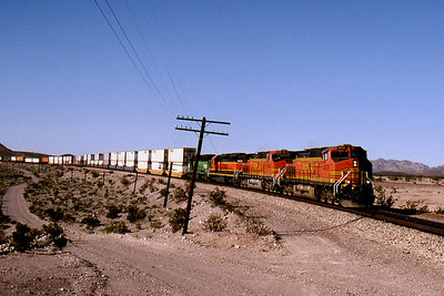 -- 2001 -- Another container train speeds east down Ash Hill on to the 1920's built divergence led by BNSF's General Electric built Dash 9-CW44 #4878. In the twenty miles from Squaw Summit at the top of Ash Hill  to the siding at Bagdad the line will drop 1,200 feet.