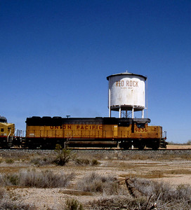 -- 2003 -- Ex-Missouri Pacific GM-EMD built SD50 #9836 dating from 1984 passes below the steam age water tower at Red Rock as it heads south towards a crew change in Tucson Yard. (0707)