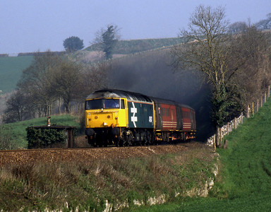 """-- 2002 -- """"Large Logo"""" liveried Class 47/8 #47847, """"Brian Morrison/Railway World Magazine""""; approaches Kerswell Bridge on the climb from Newton Abbot to Dainton Tunnel while working Virgin Cross Country's early morning service from Derby to Plymouth."""