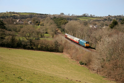"""-- 2009 -- The 14:00 from Bodmin General to Bodmin Parkway drifts down the steep grade towards Colesloggett Halt behind Class 50 #50042, """"Triumph""""; in glorious spring afternoon sunshine during the Bodmin & Wenford Railway's Spring Diesel Gala."""