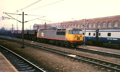 """-- 1989 -- """"Grid"""" #56089 rumbles north through Doncaster  station on a train of loaded """"Merry-go-Round"""" (MGR) wagons on a dull overcast afternoon. The engine entered service in January 1981 seeing service until it was put into store at Immingham Depot in February 2002 remaining there until it was officially withdrawn in September 2008 and finally meeting the """"Grim Reaper"""" at Booths in Rotherham six months later."""
