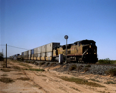 """-- 2003 -- A pair of Union Pacific's (UP) General Electric (GE) built C44-9W's pass the searchlight signal at Wymola at walking pace at the head of an eastbound  """"Double StacK service heading towards a crew change at Tucson Yard led by ex-Southern Pacific (SP) #9602. All that's left now is to drive north to the airport in Phoenix and an overnight flight back to the UK. (0708)"""