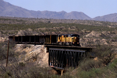 """-- 2003 -- Union Pacific 's (UP) SD60M #2394 leads an unknown  SD70M at the head of train of eastbound empty lumber carriers  crossing Cienega Creek on UP's Lordsburg Sub-Division """"Track #1"""". (0703)"""
