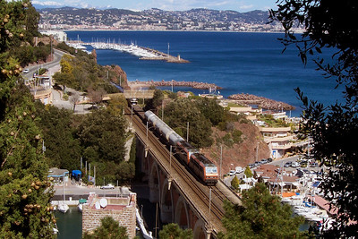 """-- 2006 -- A pair of Class BB26000 """"Sybic's"""" cross Pont du Rague in Mandelieu-la-Napoule leading a westbound freight alongside the Mediterranean   with the seafront of Cannes in the distance."""
