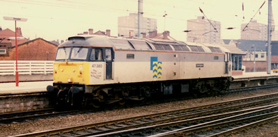"""-- 1989 -- Class 47/3 #47380, """"Immingham""""; in """"Trainload Petroleum"""" livery heads north light engine through Doncaster station. Built by Brush at their Falcon Works in Loughborough she entered service as #D1899 allocated to Immingham MPD (40B) in August 1965. She remained an Easter Region locomotive for the whole of her service life that lasted until withdrawn in June 1992. She was eventually broken-up at MC Metals in Glasgow in October 1994."""