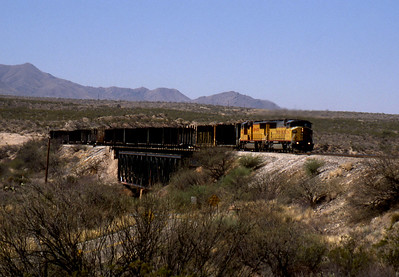"""-- 2003 -- Union Pacific 's (UP) SD60M #2394 leads an unknown  SD70M at the head of train of eastbound empty lumber carriers  crossing Cienega Creek on UP's Lordsburg Sub-Division """"Track #1"""". (0704)"""
