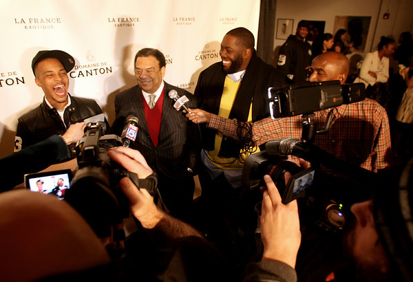 "Tip ""T.I."" Harris, Ambassador Andrew Young and Killer Mike interview at the Domaine de Canton's Holiday Party hosted by T.I. and Antwan ""Big Boi"" Patton at the Mason Murer Fine Art gallery in Atlanta on Monday, Dec. 22, 2008.  Guests were asked to bring gift and gas cards to benefit Hosea Feed the Hungry and Homeless.  ( Domaine de Canton/ Jenni Girtman/AP Photo)"
