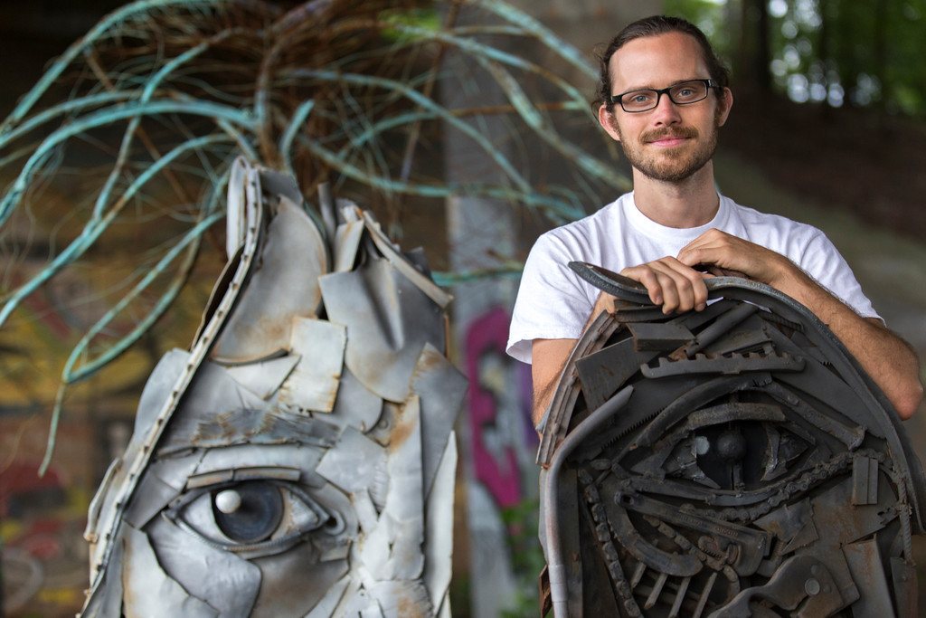 William Massey alongside his 'Object of Wo(man)' sculpture on the Eastside Trail under Freedom Parkway.  The sculpture is composed of scrap metal, concrete and paint and was commissioned by the Atlanta Beltline in 2014.  Massey walks from his home with his boarder collie Lucy to the installation.  (Jenni Girtman/ info@atlantaeventphotography.com)