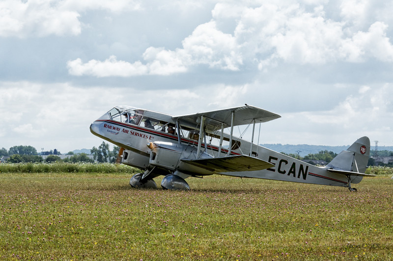 De Havilland DH.84 Dragon  G-ECAN au couleurs de la Railway Air Service Ltd (Eastern Airways)<br /> Visite de pilotes anglais sur avions de collection à Laon le 25 juillet 2009<br /> G-ECAN  -  1943 De Havilland DH-84 Dragon C/N 2048<br /> G-ECAN in the display is finished in the colours of Railway Air Services (RAS). It was built in about 1943 as part of the Australian production run for the Royal Australian Air Force (RAAF) and initially served as a navigational trainer
