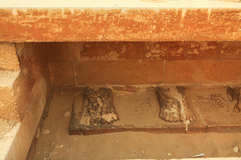 These four stone feet are all that remain of statues that previously lined a former building at the site.