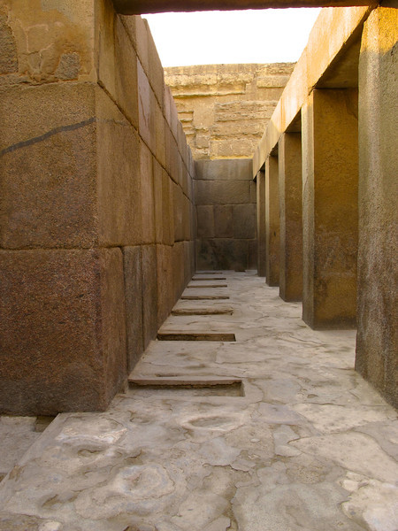 "As you pass through the wall, there's a short entrance hall.  The holes in the ""floor"" are where statues originally stood."