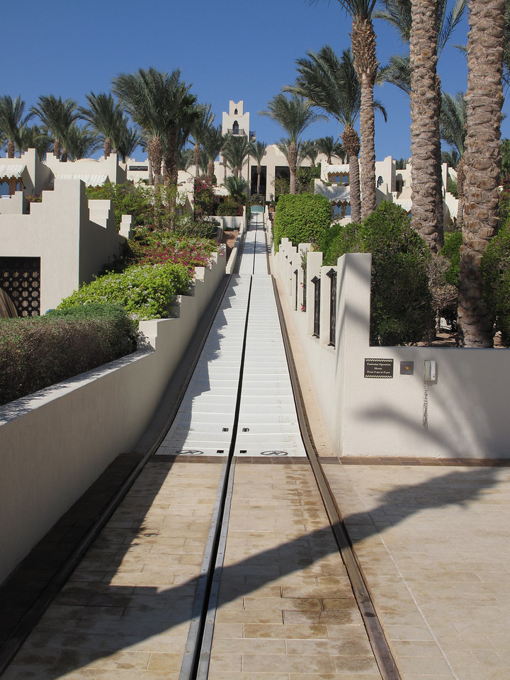 You can always request a golf cart, or take the funicular which runs from the beach to the main lobby up the hill.