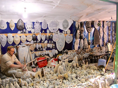 Along the narrow, rocky path to the falls, villagers have setup shops in tents, cafes, etc.  Sometimes the path goes right through the middle of the business.  Here's a shop on the trail selling alabaster sculptures & masks, which is mined in the nearby mountains.