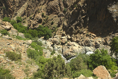 You can barely make out people hiking up the river towards the falls in the center of the picture below.