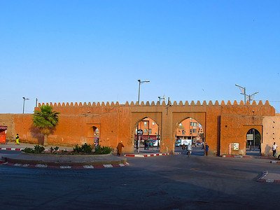 "The city walls in Marrakech date back to the early 1100s.  The walls are up to 9 m (30 ft) high and surround the ""old city"" for a distance of around 6 miles.  Throughout the wall, there are nearly 200 towers and 20 gates. This photo is the Bab Doukala gate on the northwest side of the ""old city""."