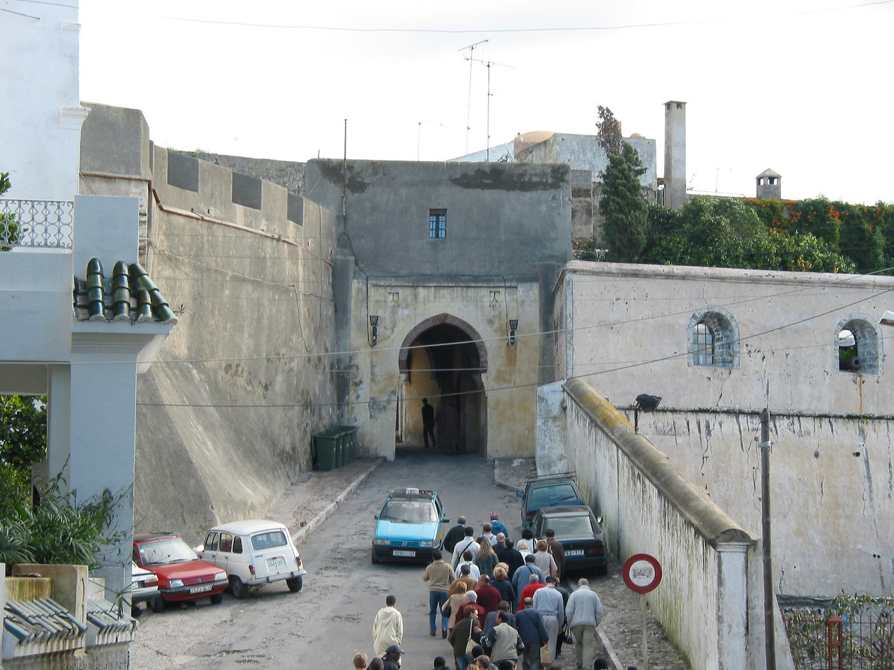 """Entrance to the """"old city"""" or medina of Tangier.  Seen here are the old city walls and one of the city gates."""