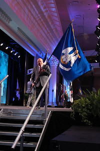 Presenting Louisiana's state flag at the 99th Annual Convention of the American Farm Bureau is Louisiana Farm Bureau President Ronnie Anderson.