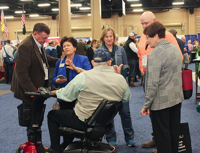 Louisiana Farm Bureau volunteer leadership from all of the state tours the IDEAg trade show at the 99th Annual American Farm Bureau Convention. Leaders include AFBF Women's Leadership Committee member Denise Hymel, former LFBF state board member Robert Warren and his wife Dena and Louisiana Farm Bureau Women's Leadership Committee 3rd Vice-Chair Bonnie Pace, far right, and her husband Jack, far left.