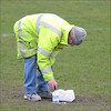 Painting the penalty spot before kick-off.