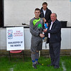 AFC Liverpool's Michael Christopher receiving his Goalkeeper of the Month award for March from the League Registrations Secretary, John Cowley.