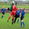 Aaron Stafford gets his head first to the ball......