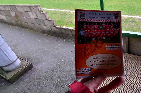 The colourful matchday programme of Colne FC.