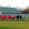 The two teams line-up and shake hands before the kick off.