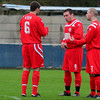 AFC Liverpool's Steve Corris, back to camera, Steven Williams and Stephen Groves.