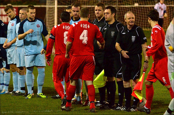 AFC Liverpool and St. Helens Town players shake hands before kick-off.