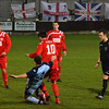 AFC Liverpool's Steve Jones and Nevil Picton watch as Liam Nethercote battles for the ball.
