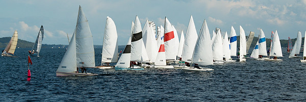 Children sailing in small colourful boats and dinghies in Australian high school championships.