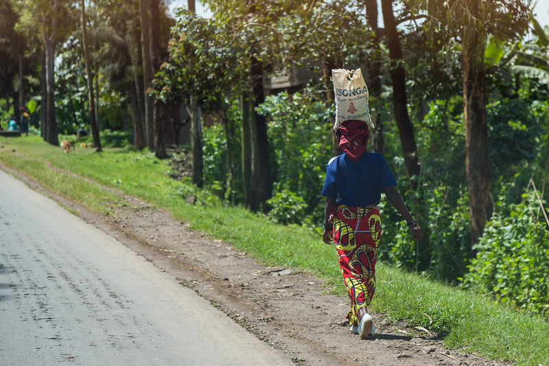 woman carrying on her head along the road - Uganda-7521